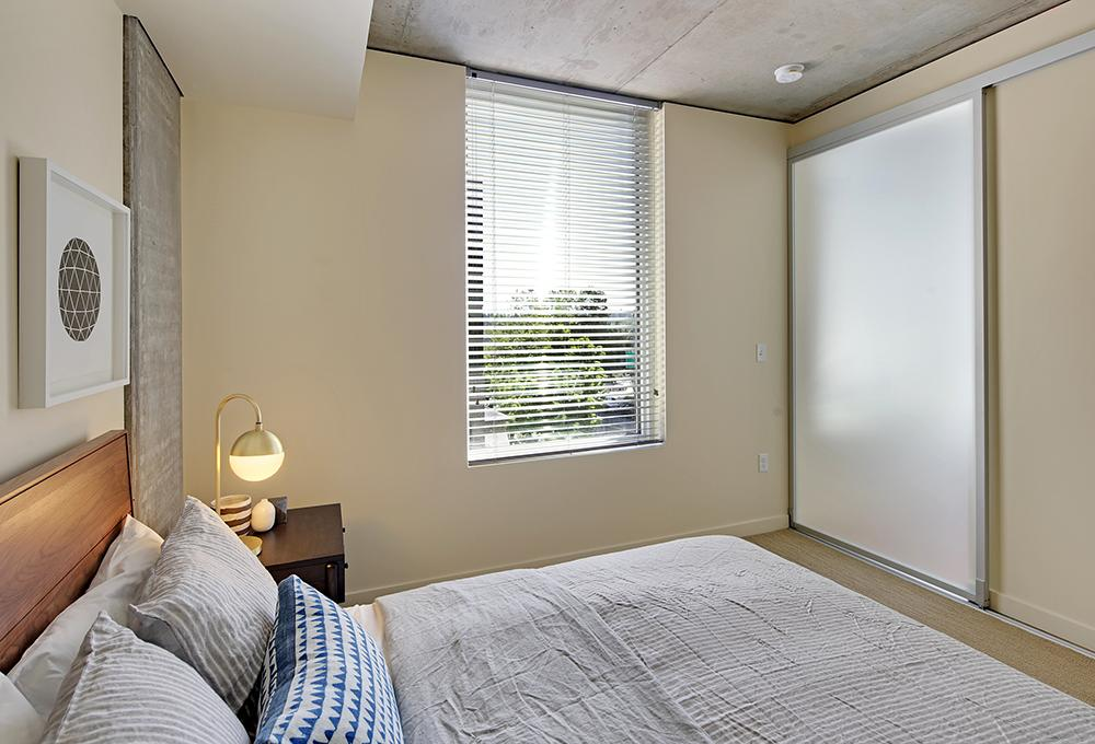 Bedroom with large window - Alley 111 Apartments