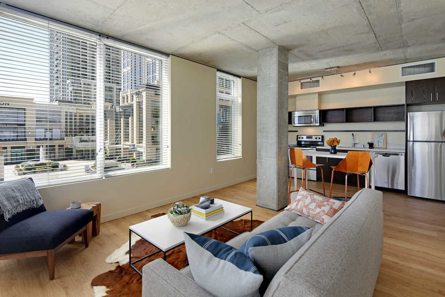 Open floor plan with modern kitchen and large windows | Alley 111 Apartments