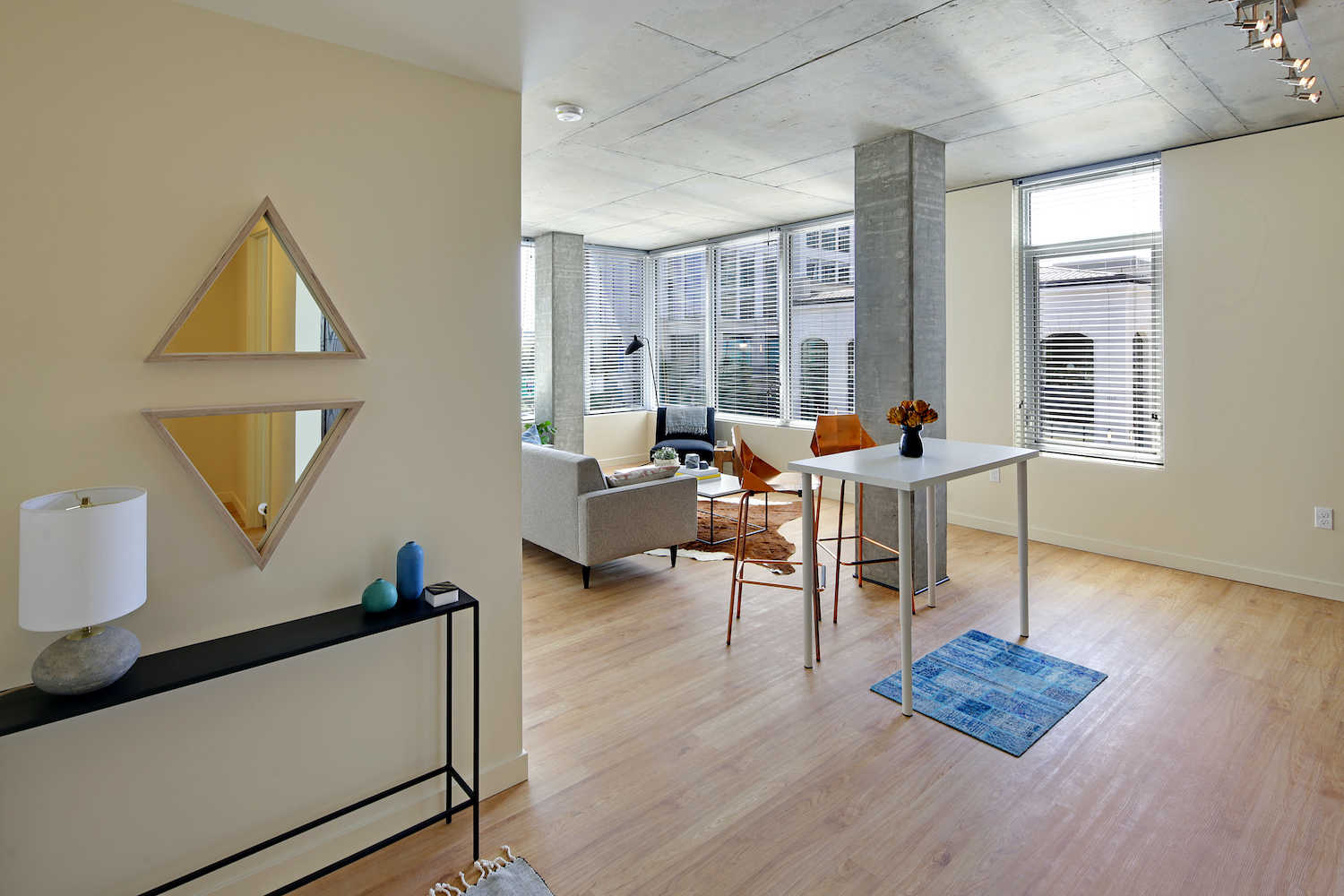 Open floor plan - plank style flooring and bright city views